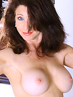 Long haired brunette MILF Madison shows off her hot body