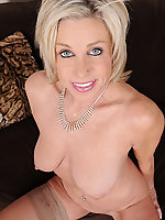 53 year old Payton Hall strips off her pink lingerie to spread wide